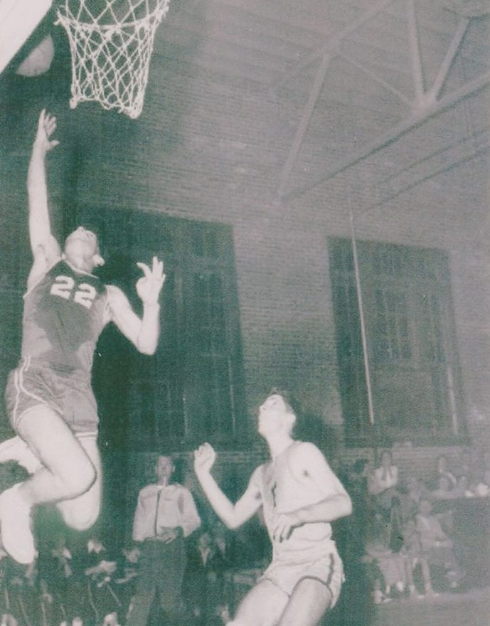 Irvin Sasser, number 22, served as captain of the Whiteville High School men's basketball team and played all four years.
