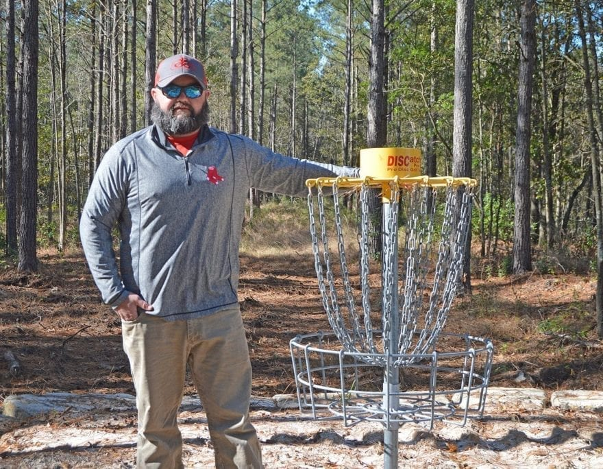 Cameron Byrd at the first hole location at the Honey Hole Disc Golf Course, which is under development with a planned finish by early 2021