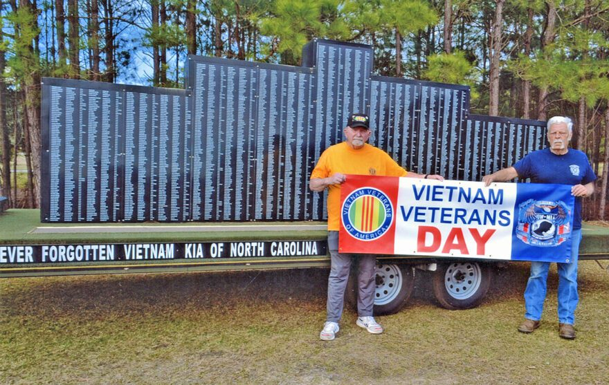 Vietnam Veterans Association Chapter 962 President Mike Creen, left, and Vice President Paul Nichols stand in front of the North Carolina Vietnam Wall that will be displayed in downtown Whiteville Monday for Vietnam Veterans Day.