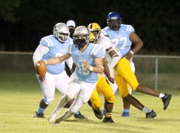 Hurricanes pound Vikings in opening round football