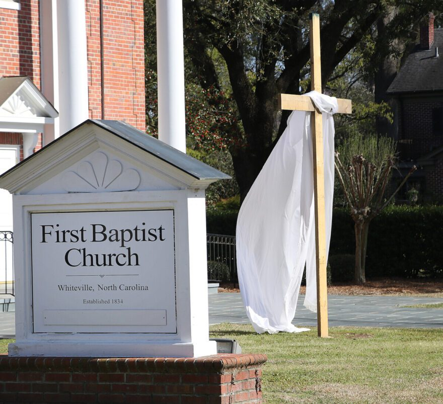 The cloth draped on the cross blows in the breeze in front of First Baptist Church on Madison Street.