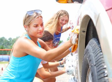 Spick and span: WHS volleyball teams hold car wash fundraiser