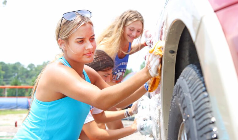 img_Spick and span: WHS volleyball teams hold car wash fundraiser